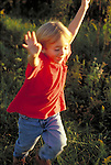 young boy running and laughing outdoors