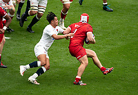 Marcus Smith (Harlequins) of England tackles Andrew Quattrin of Canada during the Autumn International match between England and Canada at Twickenham Stadium, London, England on 10 July 2021. Photo by Liam McAvoy.