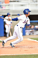 Kingsport Mets second baseman Jean Rodriguez #1 swings at a pitch during a game against the Johnson City Cardinals at Hunter Wright Stadium August 24, 2014 in Kingsport, Tennessee. The Mets defeated the Cardinals 9-1. (Tony Farlow/Four Seam Images)