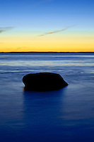 Boulder in ocean water, Rockland, Maine, USA