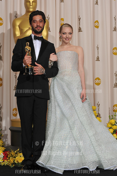Amanda Seyfried & Ryan Bingham at the 82nd Academy Awards at the Kodak Theatre, Hollywood..March 7, 2010  Los Angeles, CA.Picture: Paul Smith / Featureflash.