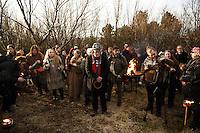 Hilmar Örn Hilmarsso, Jóhanna Harðardóttir and other priests (or gothi) of the neo-pagan Ásatrúarfélagið or Asatru association watch the hight of the solar eclipse in Reykjavik, Iceland.