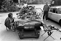 Russia. Krasnodar Krai Region. Krasnodar. City center. Open-air street market. A couple is using their Lada car as a display stand to sell car spare parts. LADA is a brand of cars manufactured by AvtoVAZ (originally VAZ), a Russian company owned by the French Groupe Renault. Krasnodar (also known as Kuban) is the largest city and the administrative centre of Krasnodar Krai in Southern Russia. 25.09.1993 © 1993 Didier Ruef