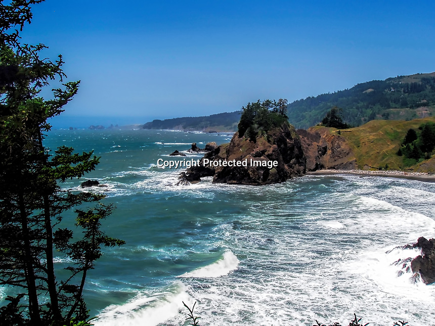 Nameless cove on the southern Oregon coast seen from a small peninsula.