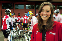 Switzerland. Canton Ticino. Tenero. Centro Sportivo Nazionale della Gioventù - Tenero (CST). Nationales Jugendsportzentrum Tenero. Vesselina Velikova is an athlete from the swiss water polo team. She stands near a group of athletes from the Swiss Cycling Federation (under 17 years old). 31.05.11 © 2011 Didier Ruef