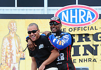 Apr. 29, 2012; Baytown, TX, USA: NHRA top fuel dragster driver J.R. Todd (left) with Antron Brown during the Spring Nationals at Royal Purple Raceway. Mandatory Credit: Mark J. Rebilas-