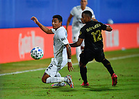 LAKE BUENA VISTA, FL - JULY 18: Julian Araujo #22 of LA Galaxy turns away from Diego Palacios #12 of LAFC during a game between Los Angeles Galaxy and Los Angeles FC at ESPN Wide World of Sports on July 18, 2020 in Lake Buena Vista, Florida.