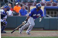 Left fielder Brandon Allen #40 of the Las Vegas 51s swings against the Omaha Storm Chasers at Werner Park on August 17, 2014 in Omaha, Nebraska. The Storm Chasers  won 4-0.   (Dennis Hubbard/Four Seam Images)