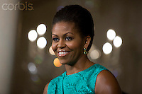 02 Dec 2009, Washington, DC, USA --- First lady Michelle Obama smiles during the holiday press preview of the White House in Washington. --- Image by © Brooks Kraft/Corbis