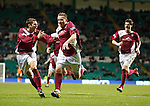 Arbroath's Steven Doris (R) celebrates after scoring from a free-kick and is chased by team-mates Danny Rennie and Stewart Malcolm