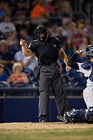 Umpire Greg Roemer calls a strike during an Eastern League game between the New Hampshire Fisher Cats and Trenton Thunder on August 20, 2019 at Arm & Hammer Park in Trenton, New Jersey.  New Hampshire defeated Trenton 7-2.  (Mike Janes/Four Seam Images)