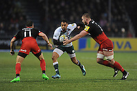 Telusa Veainu of Leicester Tigers is tackled by George Kruis of Saracens as Chris Wyles of Saracens  supports during the Premiership Rugby match between Saracens and Leicester Tigers - 02/01/2016 - Allianz Park, London<br /> Mandatory Credit: Rob Munro/Stewart Communications