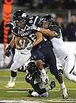 Nevada tight end Kolby Arendse runs up the middle against Hawaii defenders John Hardy-Tuliau (33) and Kenny Estes (37) during the second quarter of an NCAA football game in Reno, Nev., on Saturday Nov. 12, 2011. (AP Photo/Cathleen Allison)