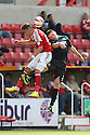 Miles Storey of Swindon and Sam Wedgbury of Stevenage challenge for a header<br />  - Swindon Town v Stevenage - Sky Bet League One- The County Ground, Swindon - 10th August 2013<br /> © Kevin Coleman 2013