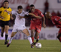 USA's Steve Cherundolo battles Panama's Luis Tejada for the ball as the USA defeated Panama 3-0 in final round World Cup qualifying at Estadio Rommel Fernandez, Panama City, Panama, on June 8, 2005.