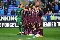 players of Swansea City line up for the minutes silence during the Sky Bet Championship match between Bolton Wanderers and Swansea City at the Macron Stadium in Bolton, England, UK. Saturday 10 November 2018