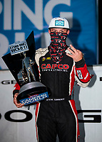 Nov 1, 2020; Las Vegas, Nevada, USA; NHRA top fuel driver Steve Torrence celebrates with the championship trophy after winning the 2020 top fuel World Championship at the NHRA Finals at The Strip at Las Vegas Motor Speedway. Mandatory Credit: Mark J. Rebilas-USA TODAY Sports