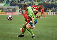 SEATTLE, WA - NOVEMBER 10: Toronto FC defender Auro #96 and Seattle Sounders defender Brad Smith #11 collide during a game between Toronto FC and Seattle Sounders FC at CenturyLink Field on November 10, 2019 in Seattle, Washington.