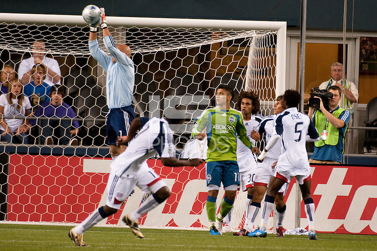 Goalkeeper Matt Ries (l) of the New England Revolution makes a save as Fredy Montero (17) and Emmanuel Osai (5) look on in the match at the XBox Pitch at Quest Field on August 20, 2009. The Revolution defeated the Sounders 1-0.