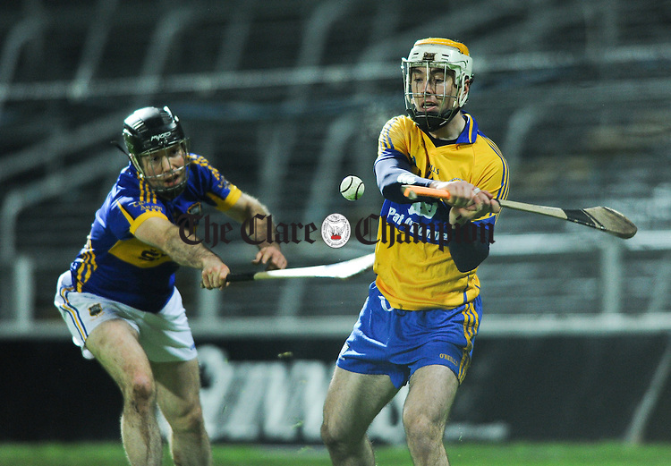 Conor O Brien of Tipperary in action against Conor Mc Grath of Clare during their Waterford Crystal Final at The Gaelic Grounds. Photograph by John Kelly.