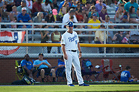 Burlington Royals manager Chris Widger (16) coaches third base during the game against the Danville Braves at Burlington Athletic Stadium on July 13, 2019 in Burlington, North Carolina. The Royals defeated the Braves 5-2. (Brian Westerholt/Four Seam Images)