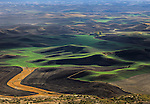 A curvy pattern among the hillsides during the last light of a summer day resembles a golf course in the Palouse of Eastern Washington State.