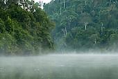 Pará State, Brazil. Aldeia Pukararankre (Kayapo). Early morning mist rising from the river.