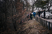 Alessandro De Marchi (ITA/BMC) is helped back to the road after having crashed into a raveen. It has taken them a while, but he will continue to race<br /> <br /> 76th Paris-Nice 2018<br /> Stage 7: Nice > Valdeblore La Colmiane (175km)