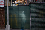A health worker watches as the body of a Covid-19 victim is transported into a temporary morgue at the Brooklyn Hospital Center in the Brooklyn borough of New York, the United States, Thursday, April 2, 2020.   Worldwide coronavirus cases have surpassed 1,000,000.  Photograph by Michael Nagle