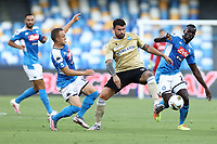 Stanislav Lobotka of Napoli and Andrea Petagna of SPAL, Kalidou Koulibaly compete for the ball<br /> during the Serie A football match between SSC  Napoli and SPAL at stadio San Paolo in Naples ( Italy ), June 28th, 2020. Play resumes behind closed doors following the outbreak of the coronavirus disease. <br /> Photo Cesare Purini / Insidefoto
