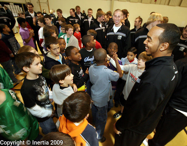 ROME, GA - DECEMBER 17: Lorenzo Brown of the University of Sioux Falls, talks with students at West Elementary School in Rome, GA, on Thursday morning, Dec. 17. The University of Sioux Falls Cougars are in Rome to play Lindenwood University Lions for the NAIA Football Championship on Saturday. (Photo by Dave Eggen/Inertia)
