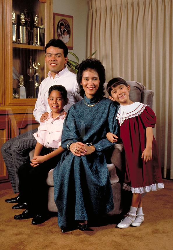 HISPANIC (MEXICAN-AMERICAN) FAMILY IN THE LIVING ROOM. HISPANIC FAMILY. FRESNO CALIFORNIA.