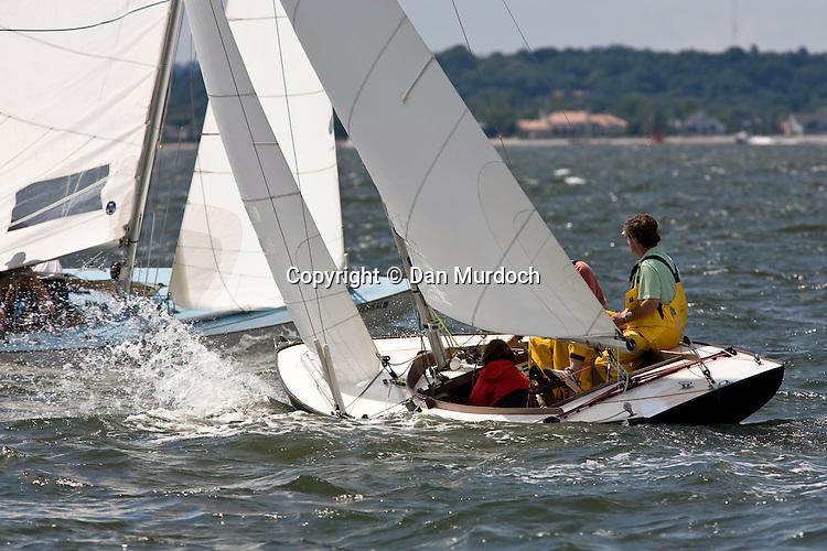 close action between two racing atlantic sailboats