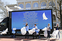 Vickie Price (from left), DesaRae Crouch, Holly Clarke and Carolyn Shewmaker release dove balloons, Friday, April 2, 2021 at the downtown square in Bentonville. The Children's Advocacy Center of Benton County Pinwheels for Prevention kicked off Child Abuse Awareness Month with speakers and an honorary dove release in remembrance of children lost to abuse in the community. Check out nwaonline.com/210403Daily/ for today's photo gallery. <br /> (NWA Democrat-Gazette/Charlie Kaijo)