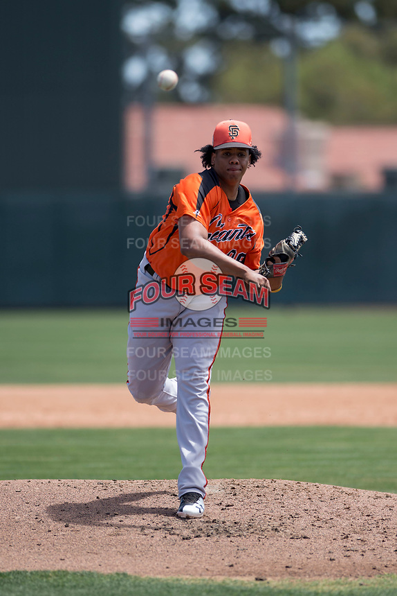 San Francisco Giants Orange starting pitcher Johan Herrera (86) follows through on his delivery during an Extended Spring Training game against the Oakland Athletics at the Lew Wolff Training Complex on May 29, 2018 in Mesa, Arizona. (Zachary Lucy/Four Seam Images)