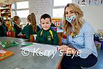 Fiónn Ó Mathúna's first day back at school in Gaelscoil Lois Tuathail on Monday with his senior infants teacher Héléna D'Alessandro