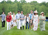 Euro-jockey Jimmy McCarthy (center) leads a course walk at the Queens Cup.