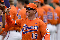 Head coach Monte Lee (18) of the Clemson Tigers is introduced to the crowd before a game against the South Alabama Jaguars on Opening Day, Friday, February 15, 2019, at Doug Kingsmore Stadium in Clemson, South Carolina. Clemson won, 6-2. (Tom Priddy/Four Seam Images)
