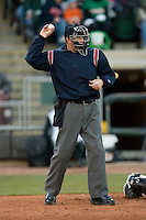 Home plate umpire Matt Neuhold throws a baseball to the pitcher during a Midwest League game between the Great Lakes Loons and the Dayton Dragons at Fifth Third Field April 22, 2009 in Dayton, Ohio. (Photo by Brian Westerholt / Four Seam Images)