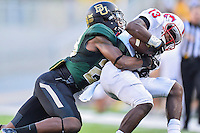 Baylor safety Orion Stewart (28) brings down SMU wide receiver Ryheem Malone (13) during second half of NCAA Football game at McLean Stadium, Sunday, August 31, 2014 in Waco, Tex. Baylor defeated SMU 45-0. (Mo Khursheed/TFV Media via AP Images)