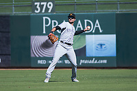 Salt River Rafters right fielder Sam Hilliard (14), of the Colorado Rockies organization, throws to the infield during an Arizona Fall League game against the Surprise Saguaros on October 9, 2018 at Surprise Stadium in Surprise, Arizona. The Rafters defeated the Saguaros 10-8. (Zachary Lucy/Four Seam Images)