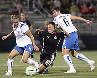 Homare Sawa #10 of the Washington Freedom falls between Heather Mitts #2 and Amy LePelbet #6 of the Boston Breakers during a WPS match at Maryland Soccerplex on July 29, in Boyds, Maryland. Freedom won 1-0.