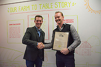 """Wolf Starr of Connect Columbus shakes hands with Morgan Spurlock after presenting his with a proclamation from the state of Ohio congratulating him on the opening of his new restaurant.<br /> <br /> Morgan Spurlock opens """"Holy Chicken,"""" a faux fast food restaurant in Columbus, Ohio, where a documentary crew recorded his interaction with customers who thought they were dining at a new type of fast food restaurant. However, the entire location was designed to be part of his documentary highlighting the marketing of food that may not be as healthy as it is stated in advertisement, banners, and notices at the restaurant."""