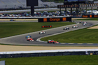 Rubens Barrichello (#2-Ferrari) and teammate Michael Schumacher (#1-Ferrari) lead the field.