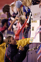 """USA's Abby Wambach signs autographs after the game. The US Women's National Team tied the Denmark Women's National Team 1 to 1 during game 8 of the 10 game the """"Fan Celebration Tour"""" at Giant's Stadium, East Rutherford, NJ, on Wednesday, November 3, 2004.."""