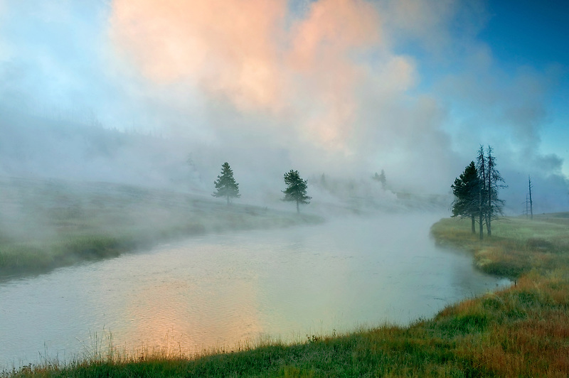 Firehole River at sunrise with geothermal hotsprings. Yellowstone National Park, Wyoming