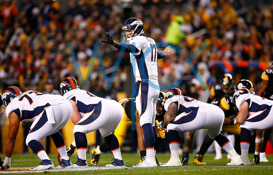 Brock Osweiler #17 of the Denver Broncos stands behind center in the first half against the Pittsburgh Steelers during the game at Heinz Field on December 20, 2015 in Pittsburgh, Pennsylvania. (Photo by Jared Wickerham/DKPittsburghSports)