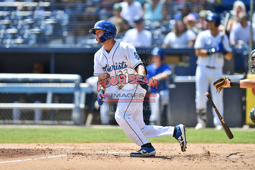 Asheville Tourists Willie MacIver (23) runs to first base during a game against the Charleston RiverDogs at McCormick Field on August 18, 2019 in Asheville, North Carolina. The Tourists defeated the RiverDogs 6-5. (Tony Farlow/Four Seam Images)