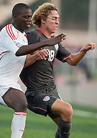 Andrew Craven battles for the ball. US Men's National Team Under 17 defeated Malawi 1-0 in the second game of the FIFA 2009 Under-17 World Cup at Sani Abacha Stadium in Kano, Nigeria on October 29, 2009.