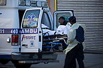Healthcare works loads patient into an ambulance outside of Wyckoff Heights Medical Center during the coronavirus pandemic on April 6, 2020 in New York City.  More than 10,000 people have died from COVID-19 in the U.S..  Photograph by Michael Nagle